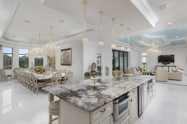 The fully equipped kitchen flows between the living area and dining room