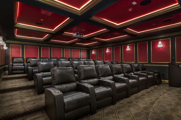The theater offers luxurious leather seating, a podium with microphone and stage