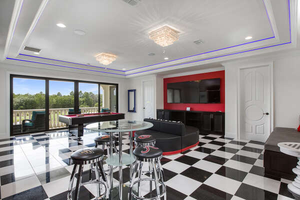 Gather in the sports bar themed games room to enjoy a round of pool or 6 TVs