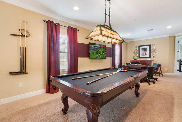 The upstairs loft game room features a pool table