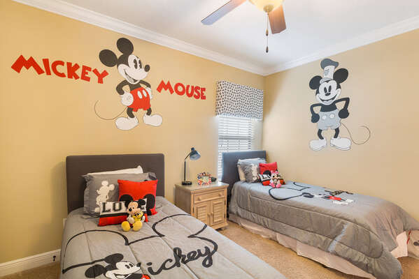 Another kids bedroom upstairs with custom artwork