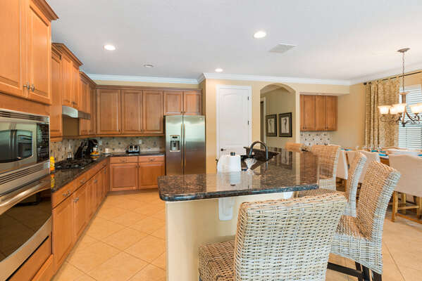 The gourmet kitchen is fully equipped featuring stainless steel appliances