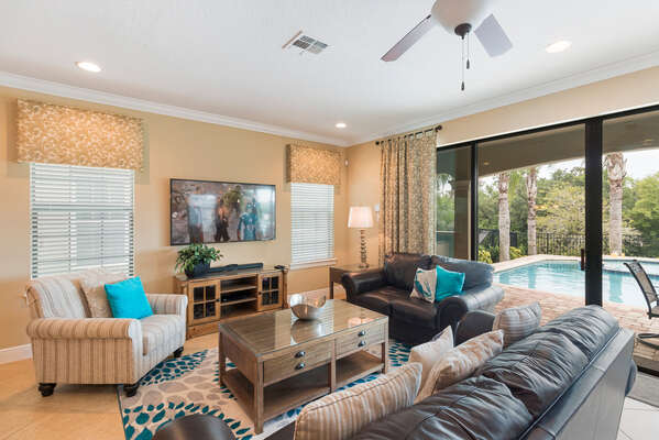 The open concept living area has plenty of natural light and seating for everyone