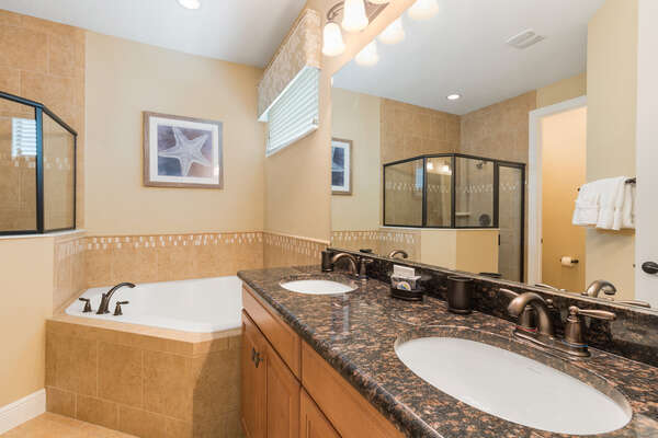 ensuite master bathroom with luxurious bathtub