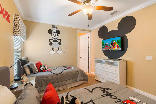 Twin beds for the kids and their own TV