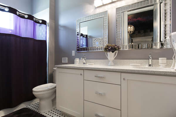 A private bathroom for the princess features dual vanity and shower/tub combination