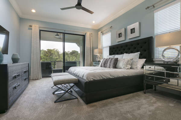 This master suite has a king bed, 50-inch SMART TV, and access to the patio balcony
