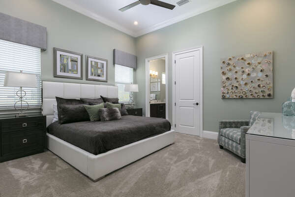 This master suite located on the ground floor features a king size bed, en-suite bath, and 50-inch SMART TV