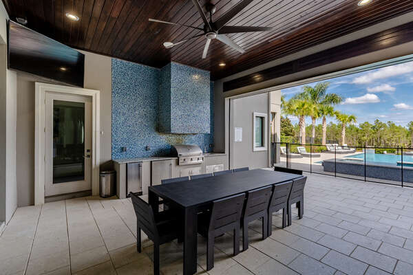 Prepare a delicious meal at the large summer kitchen and dine al fresco at the outdoor dining table