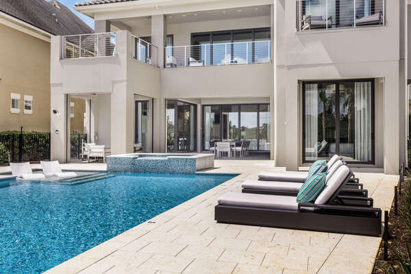 Enjoy this custom infinity pool with a spillover spa