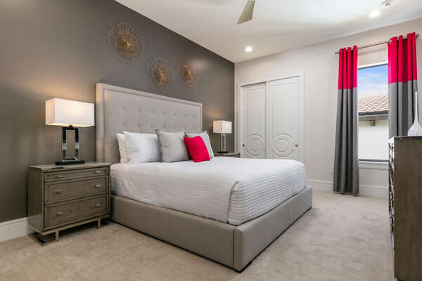 A second floor King sized bedroom featuring luxury furnishings