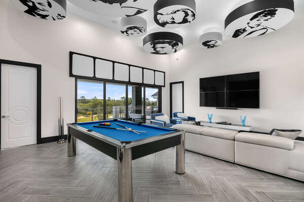 The luxurious loft games room on the second floor featuring some familiar faces