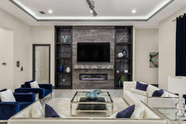 A 82-inch 4K SMART TV and plenty of comfortable seating (Disclaimer: Fireplace(s) not allowed for guest use, homeowner use only.)