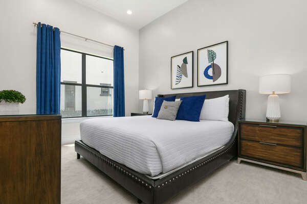Another bedroom located on the main floor with a comfortable King sized bed