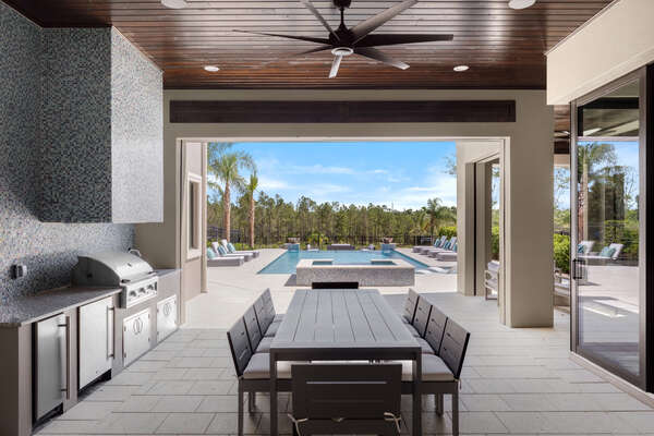 A fully equipped summer kitchen with plenty of seating for everyone