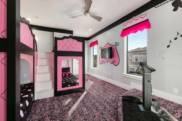 A pretty in pink bedroom thoughtfully designed for the kids