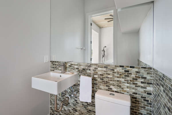 A half bathroom with convenient access from the pool area