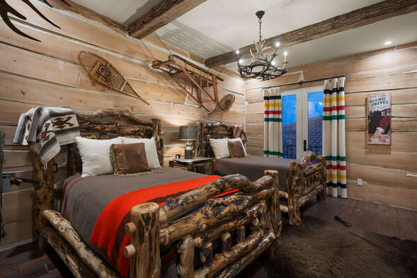 The Jackson Hole theme bedroom has two custom full beds with a 48-inch SMART TV