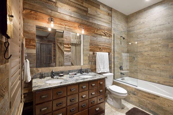 The en-suite bathroom has dual vanity and 6-foot tub
