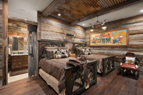 This bedroom has western ranch decor and a 48-inch SMART 4K TV to enjoy