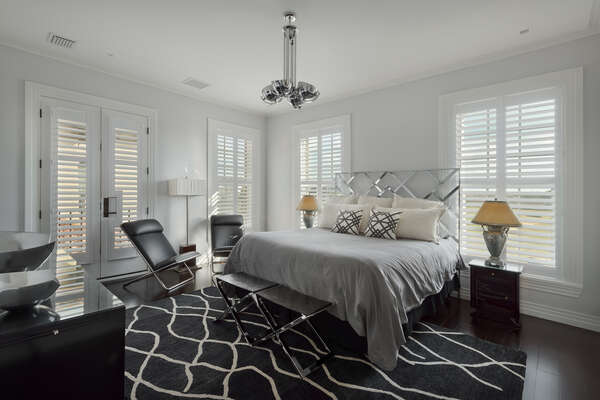 The New York theme master suite features elegant furnishing and Art Deco decor
