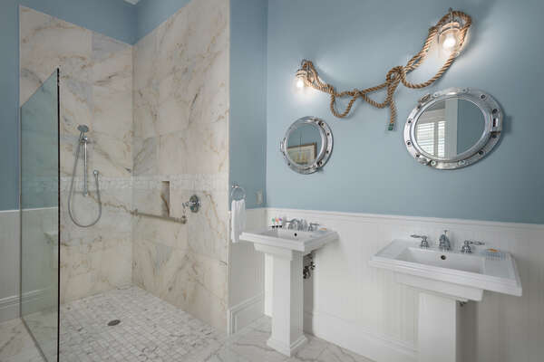 The en-suite bath has dual vanity and walk-in shower