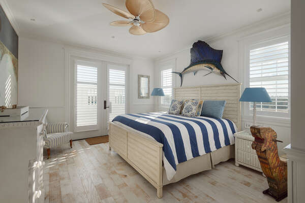 The Key West theme master suite feature beach and ocean decor