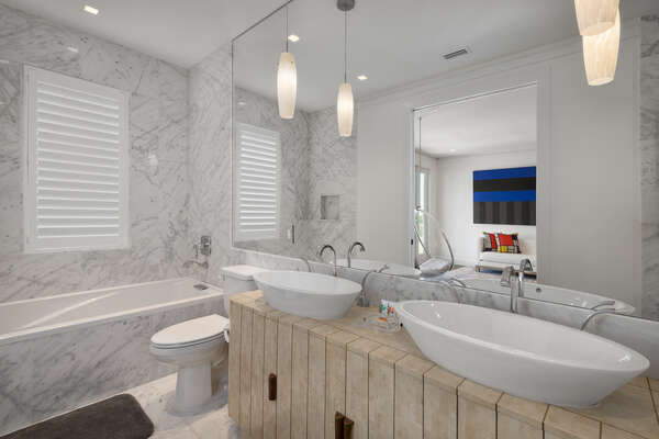 The master en-suite bathroom has dual vanity, marble soaking tub and shower