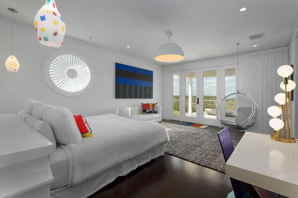 The master suite 3 features 1960s Modern decor with access to the patio balcony