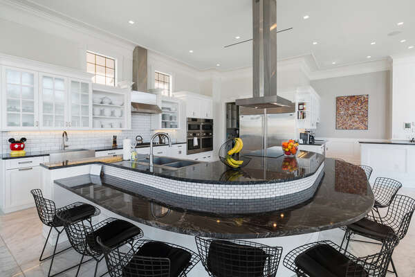 The gourmet kitchen is designed to prepare any meal with black granite countertops, Sub-Zero, Viking, and Bosch appliances