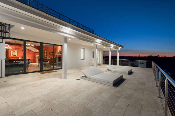 The patio balcony is perfect to catch the sunset