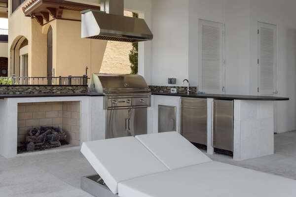 A summer kitchen to prepare a barbecue meal (Disclaimer: Fireplace(s) not allowed for guest use, homeowner use only.)