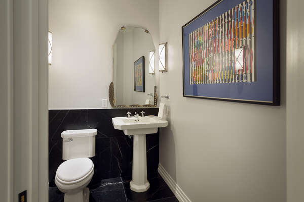 A half bathroom located off the second floor near the theater room
