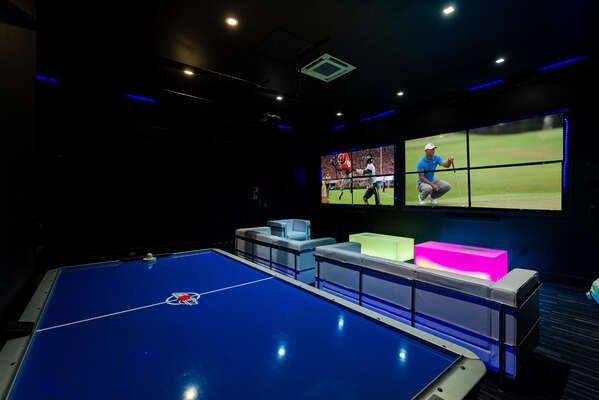 Play a game of air hockey in this fun blacklight Kids Club