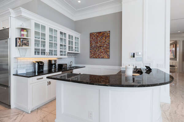 A wet bar with everything you need and iPad to control homes Sonos Music System