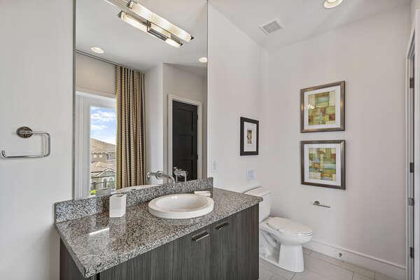 A half bathroom located on the third floor