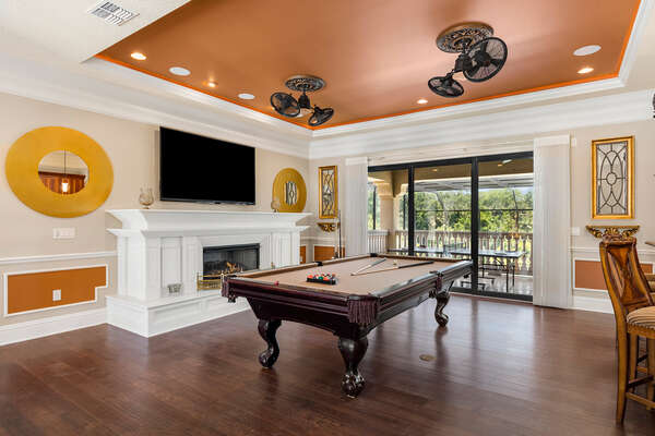 The second floor loft has a pool table and 80 inch SMART TV