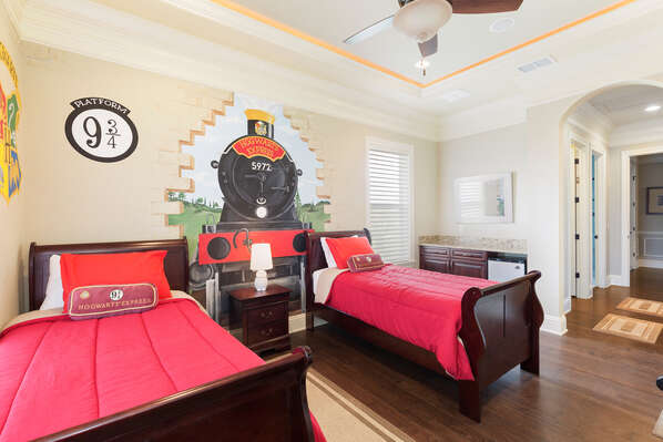 This bedroom features two twin beds, snack bar with mini fridge, and an en-suite bathroom