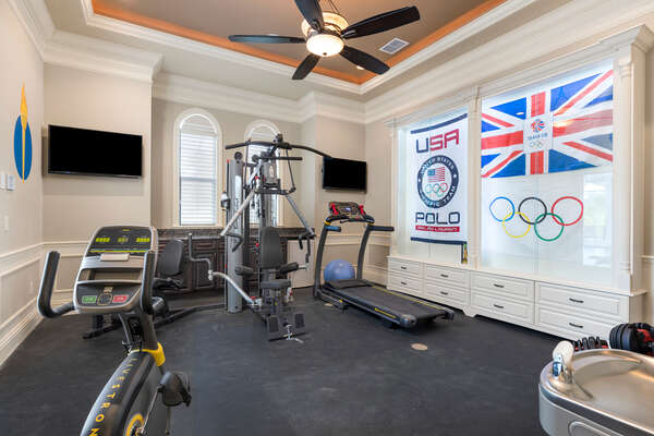 The private gym has an Olympic theme, 2 TVs, and multiple pieces of equipment