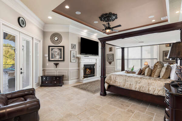 Unwind in your master suite with 80 inch SMART TV, fireplace, and easy access to the pool