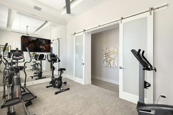 A fully equipped fitness room on the second floor