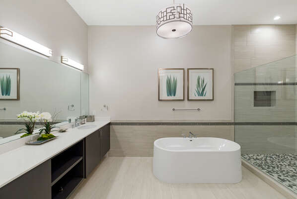 The en-suite bathroom features dual vanity and garden tub