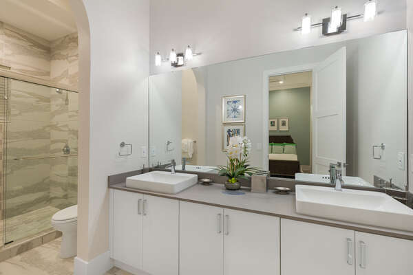 En-suite bathroom with dual vanity and walk-in shower