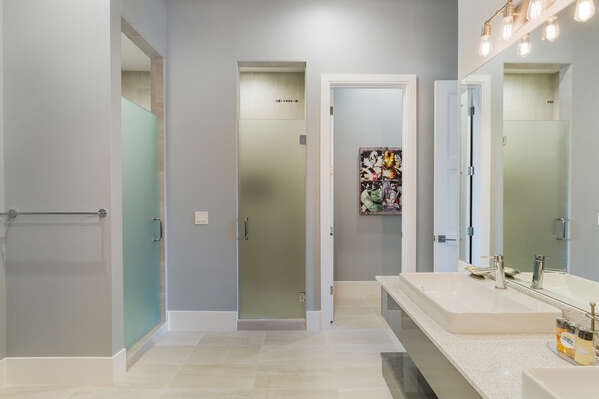 The en-suite bathroom features two walk-in shower