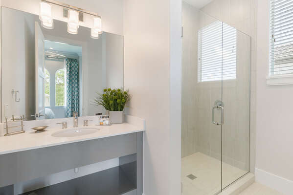 The en-suite bathroom features a glass walk-in shower