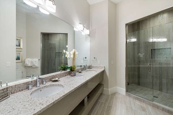 En-suite master bath with glass door walk-in shower and dual vanity