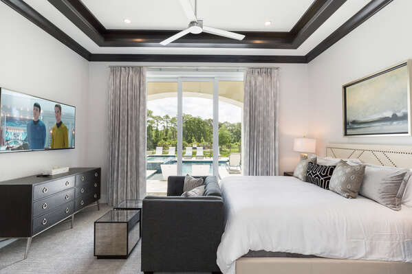 Master Suite 2 with king bed, en-suite bathroom, and access to the pool area