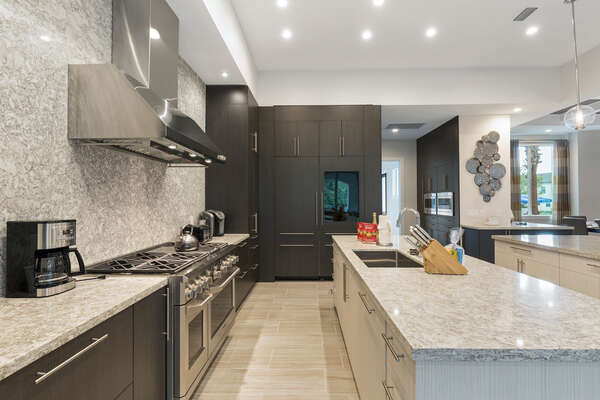 The fully equipped kitchen features stainless steel appliances