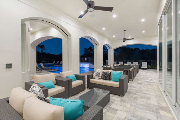 Relax under the covered lanai with comfortable outdoor furniture