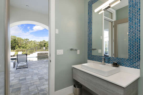 A half bathroom located off of the covered lanai